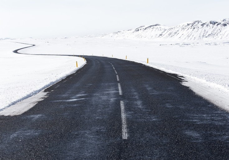 Long-winding-road-in-the-snowy-mountains